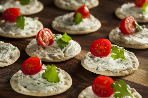 Cracker and Cheese Hors D'oeuvres with Tomato and Parsley